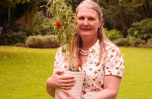 Ambassador le Jeune d'Allegeershecque planting poppy for WW1 commemorations