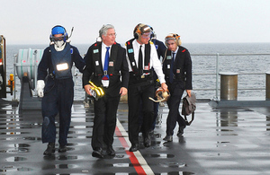 Defence Secretary Michael Fallon (second from left) arriving on board HMS Duncan [Picture: Leading Airman (Photographer) Ben Shread, Crown copyright]