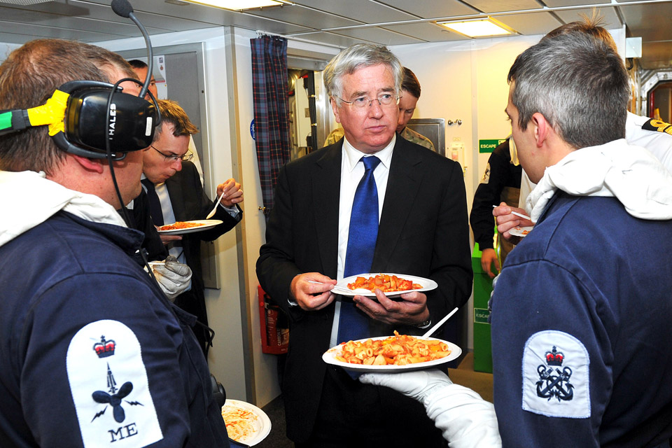 Defence Secretary Michael Fallon eating in the mess on board HMS Duncan
