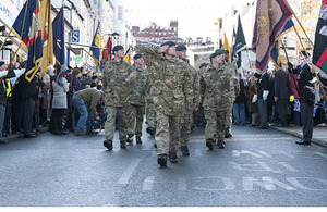 Crowds cheer on soldiers of 1st Battalion The Rifles as they march through Chepstow