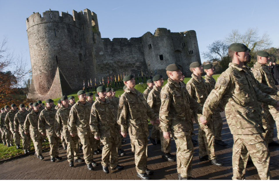 Soldiers of 1st Battalion The Rifles march past Chepstow Castle