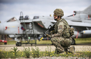 An airman from 31 Squadron stands guard in front of a Tornado GR4 aircraft [Picture: Corporal Andy Holmes RAF, Crown copyright]
