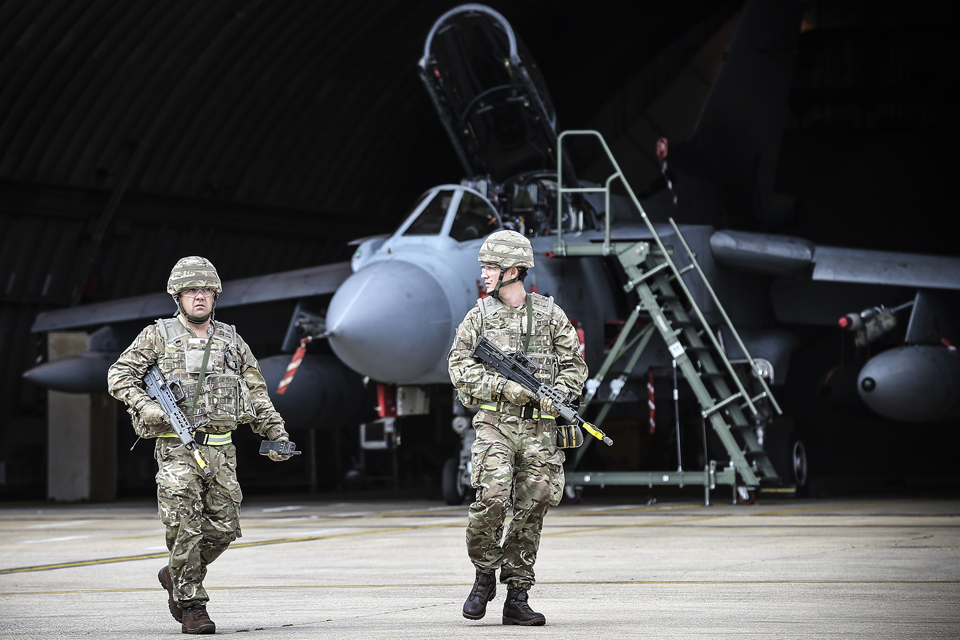 Two aircraft technicians from 31 Squadron