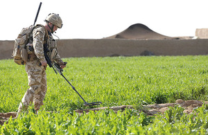 A British soldier carries out counter-IED drills during a patrol in Helmand province