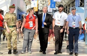 Defence Secretary Michael Fallon with members of the military venue security force supporting the Commonwealth Games [Picture: Mark Owens, Crown copyright]