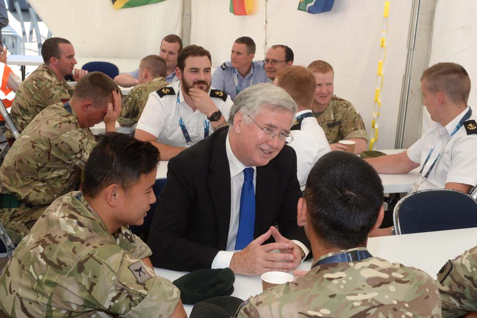 Michael Fallon chatting to members of the military venue security force