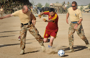 An Afghan player gains control of the ball during the game against Denmark