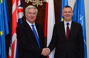 Defence Secretary Michael Fallon (left) shakes hands with the Polish Minister of National Defence Tomasz Siemoniak