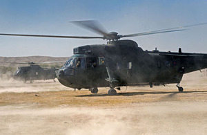 Royal Navy Sea King helicopters land at a forward operating base in Helmand province (stock image)