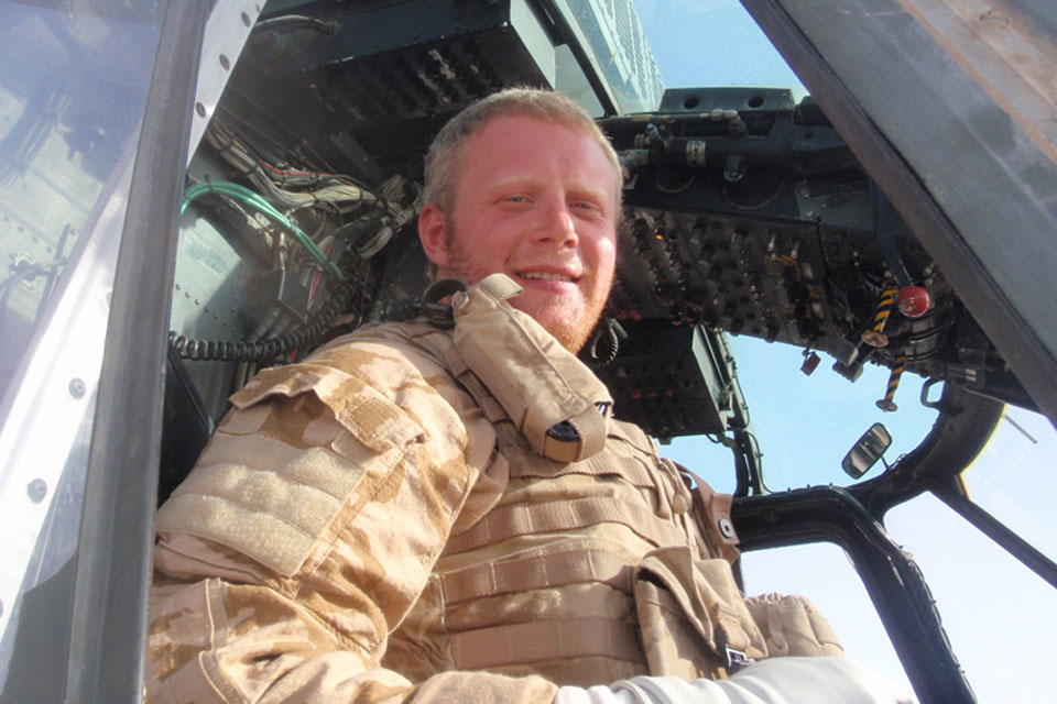Royal Navy helicopter pilot Lieutenant Charlie Talmage in the cockpit of a Sea King Mark 4 in Helmand