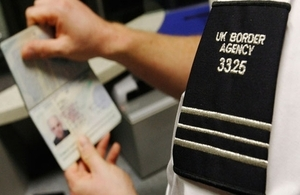 Border Service checking a passport
