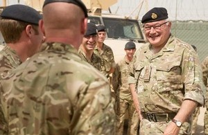 General Sir Peter Wall shares a laugh with soldiers of the Queen's Dragoon Guards [Picture: Cpl Daniel Wiepen, Crown copyright]