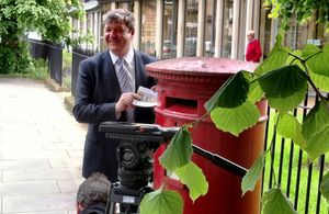 Alistair Carmichael at postbox