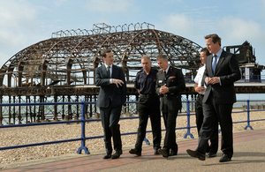 David Cameron, George Osborne and members of the East Sussex Fire and Rescue Service in front on Eastbourne Pier