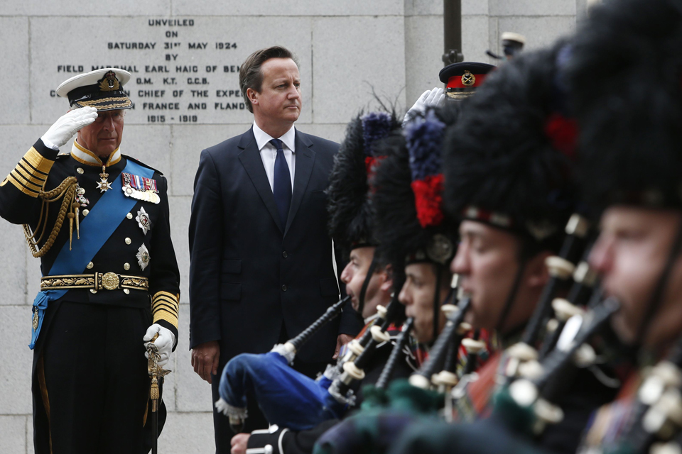 The Prince of Wales and Prime Minister David Cameron during a wreath-laying ceremony at the Cenotaph in Glasgow.
