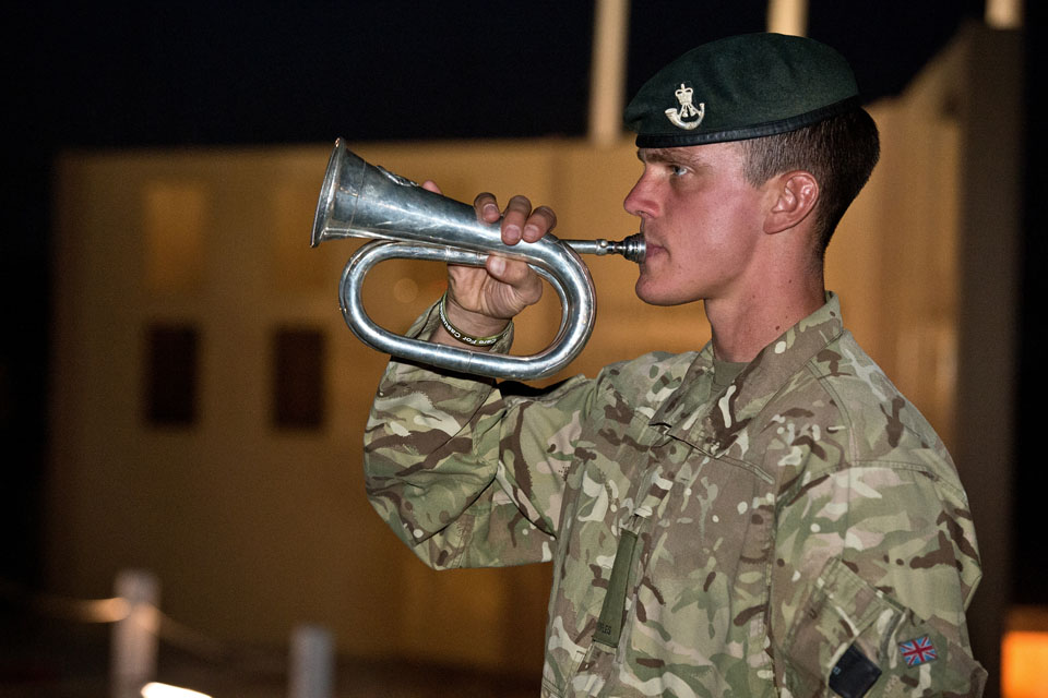 A soldier plays the Last Post