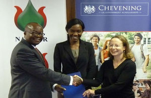 Managing Director of Namcor, Obeth Kandjoze, Alina Haidula, Chevening recipient, and HE Marianne Young exchanging the MoU