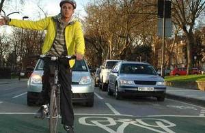 Person signalling on bicycle.