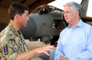 Defence Secretary Michael Fallon meets the commanding officer of 904 Expeditionary Air Wing at Kandahar Airfield [Picture: Corporal Chantelle Cooke RAF, Crown copyright]
