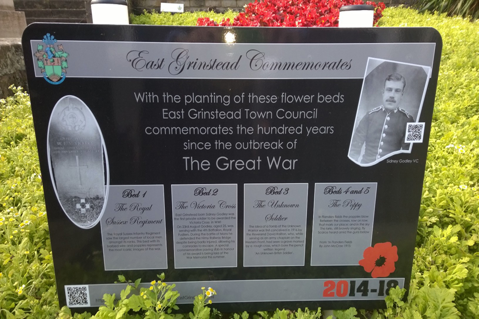 Memorial to Private Sidney Godley VC in East Grinstead high street alongside the paving stone