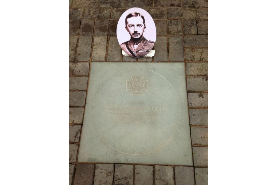 Victoria Cross paving stone in honour of Captain Douglas Reynolds.