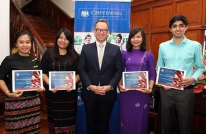 Chargé d'affaires of the British Embassy Rangoon, Mr Matthew Hedges, with four Chevening Scholars