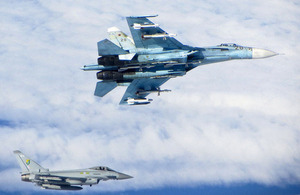 A Russian SU-27 Flanker (top) with a RAF Typhoon fighter