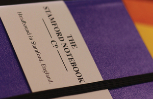 A purple notebook from The Stamford Notebook Company