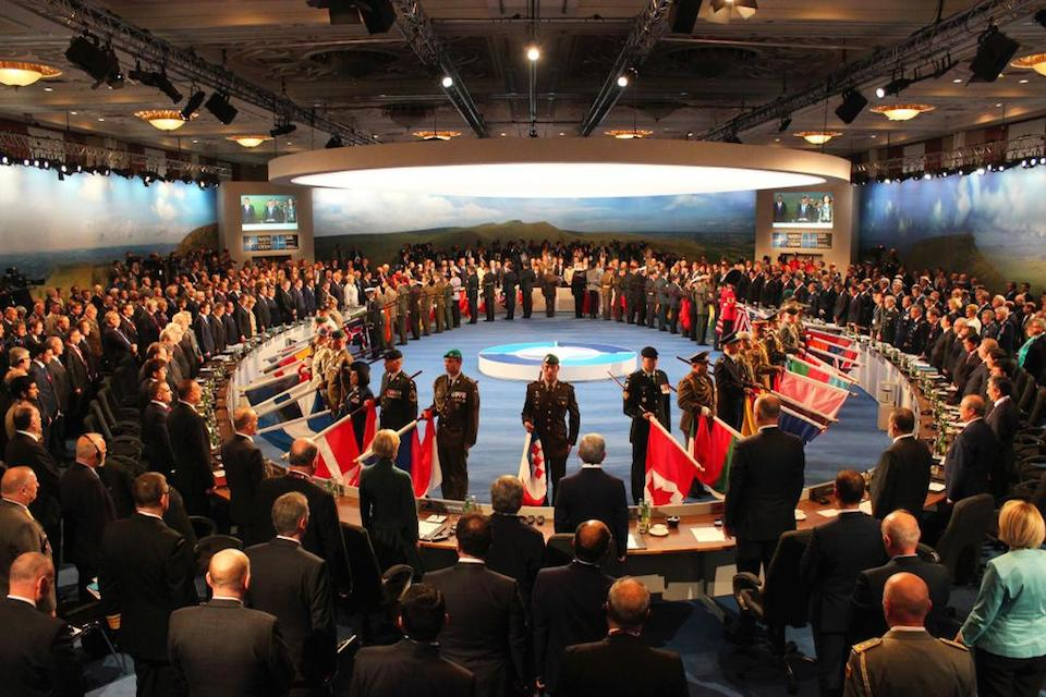 Military procession at NATO working session on Afghanistan.