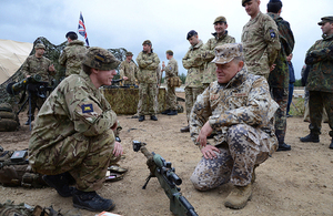 The Latvian Chief of Defence meeting British soldiers during a NATO training exercise [Picture: John Hall]