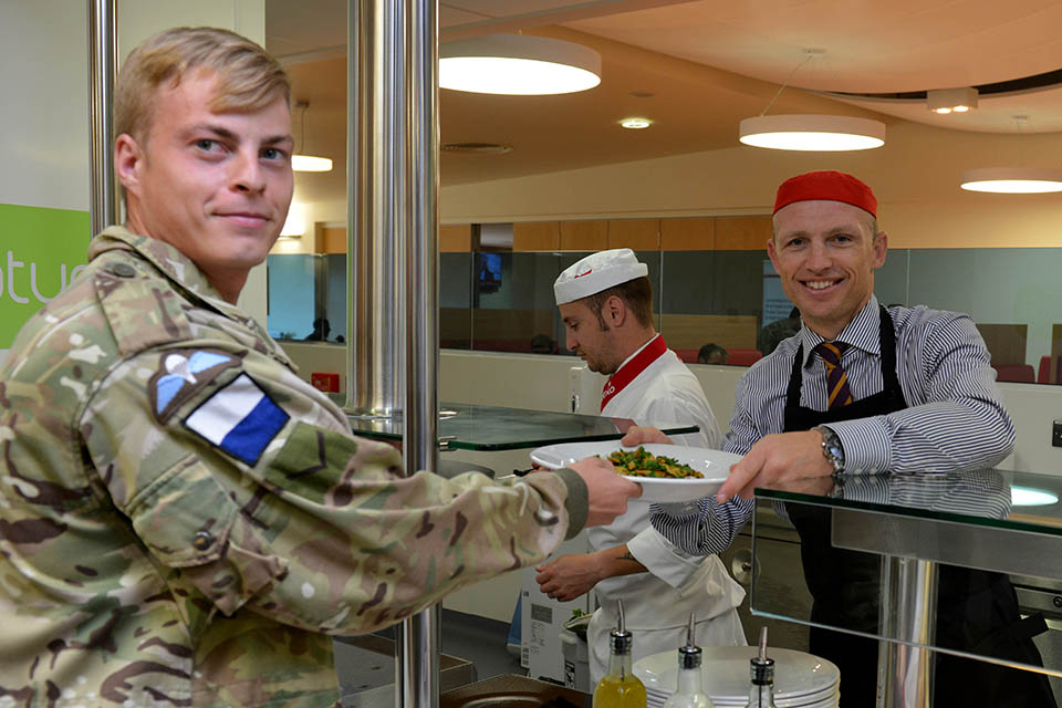 Matt Dawson serving a soldier at one of the new Merville Barracks restaurants
