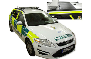 Green ambulance with solar roof panel.