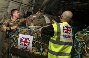 Aid supplies for northern Iraq being checked on board aircraft.