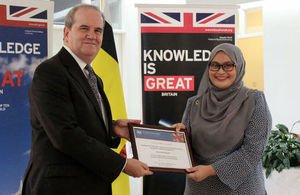 British High Commissioner David Campbell presenting Siti Nurfateha Abdullah with a certificate