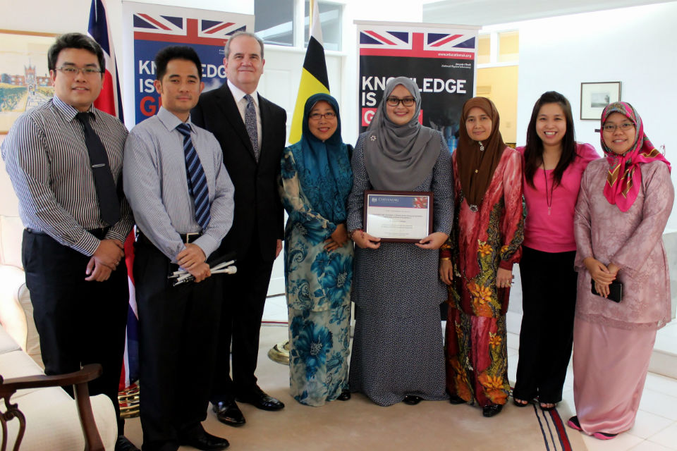 British High Commissioner David Campbell with Siti Nurfateha Abdullah and Brunei Chevening Alumni