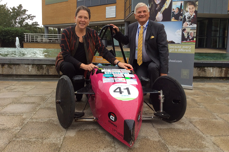 Baroness Kramer and green racing car.