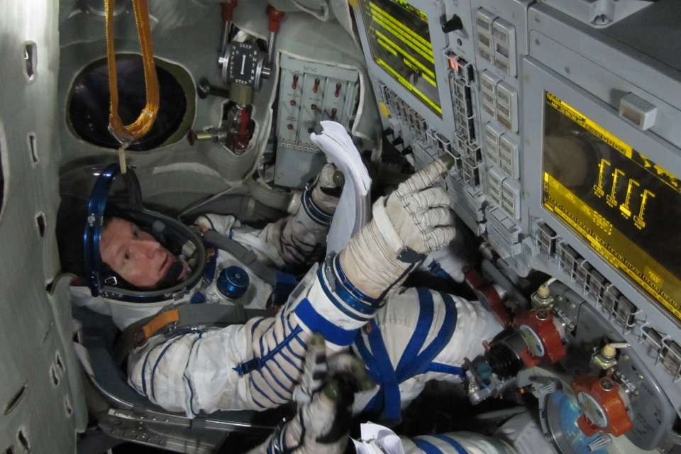 Timothy Peake training in Soyuz simulator.