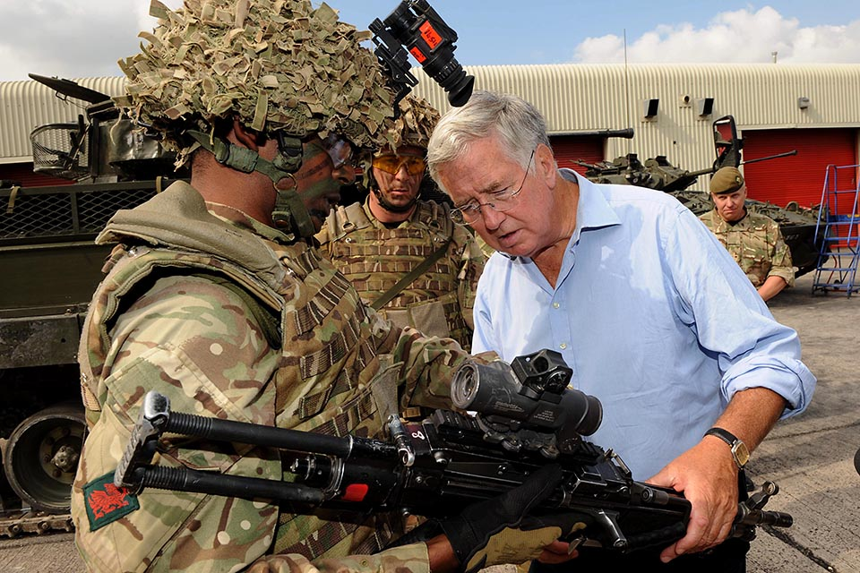 Soldier shows Michael Fallon his weapon