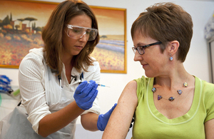 Volunteer Ruth Atkins receives an experimental Ebola vaccine. Picture: Wellcome Trust