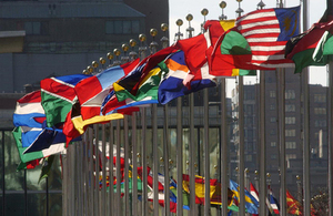 Flags of member nations flying at the United Nations headquarters.