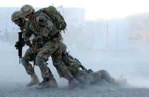 Royal Marines commandos drag an 'injured' colleague to safety during a training exercise (library image) [Picture: Petty Officer (Photographer) Sean Clee, Crown copyright]