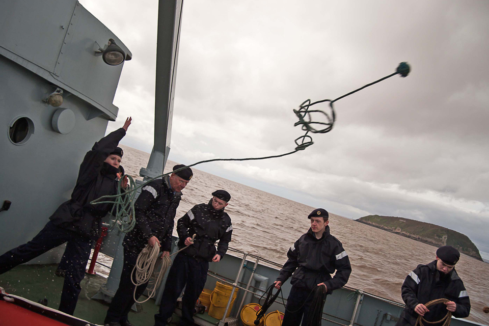 A Royal Naval reservist practising rope-throwing