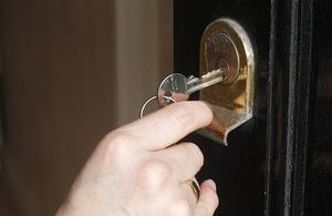 Key opening a front door