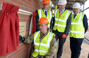 Brigadier Greg Wilson unveils the commemorative foundation stone with (from left) Richard McCarthy, John Leary and Gordon Ray [Picture: Corporal Tim Hammond, Crown copyright]