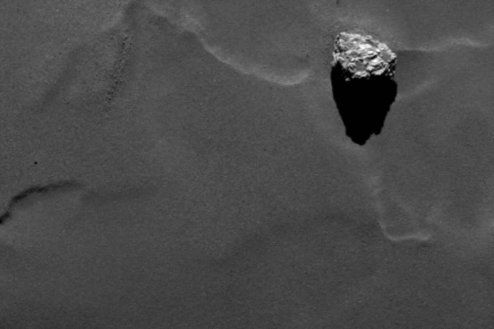 Close-up of the boulder Cheops as it casts a long shadow on the surface of comet 67P/Churyumov-Gerasimenko.