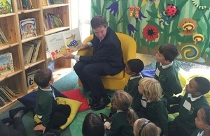 Nick Clegg reads to children at a primary school.