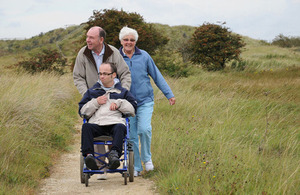 Family enjoying the access for all trail at Saltfleetby-Theddlethorpe Dunes NNR