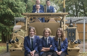 Students sitting on a Jackal armoured vehicle