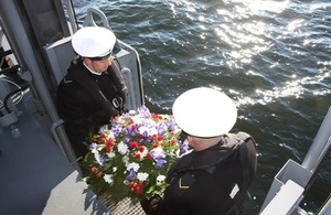 Wreath laying in the sea