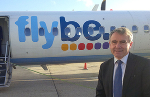 Robert Goodwill with Flybe aeroplane.